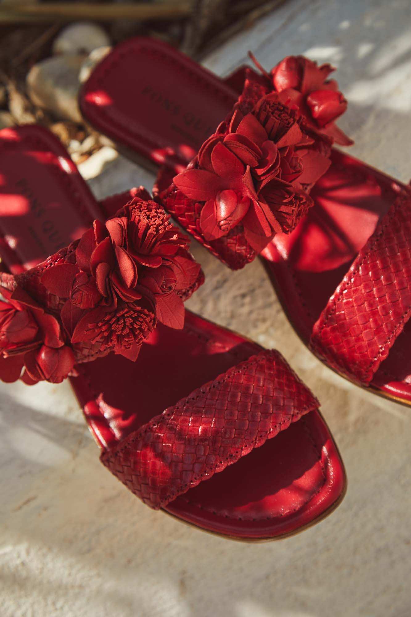 RED BRAIDED FLAT SANDAL
